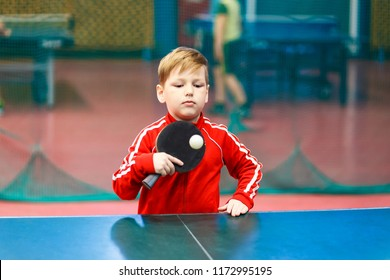 a boy playing table tennis, ping pong