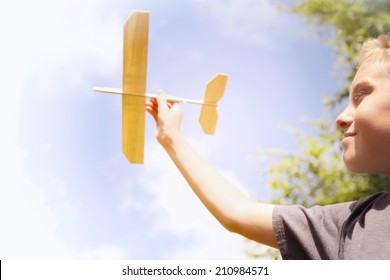 Boy playing with Toy airplane in the sky