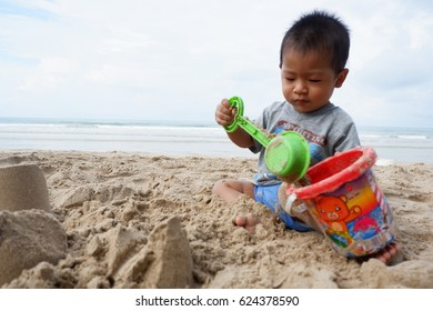 The Boy playing a toy at the beach