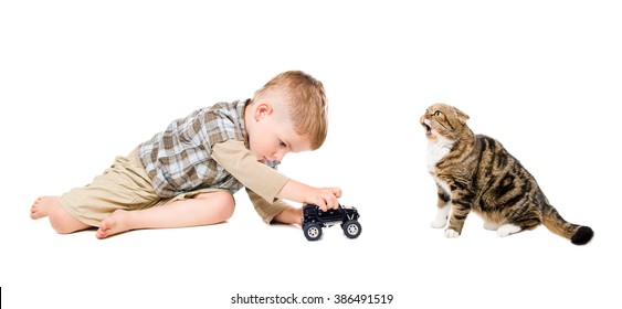 Boy playing toy car together with cat isolated on white background