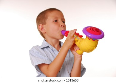 Boy playing a toy Saxophone