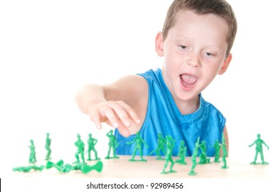 Boy playing with toy soldiers