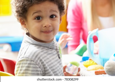 Boy playing with toys in nursery