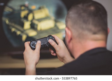 Boy playing a video game on joystick,video game.