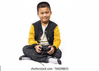 Boy playing video games joystick isolated white background.