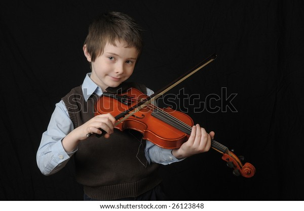 Boy Playing Violin Isolated Over Black Stock Photo (Edit Now