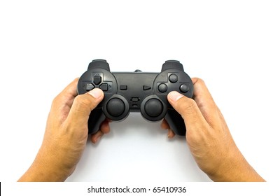 The boy plays a computer game with the help joystick