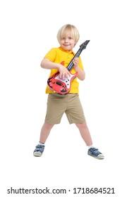 Boy plays on toy guitar isolated on white background