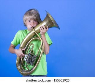 A boy plays the trumpet.