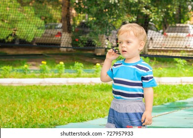 A boy plays with a volleyball net in the Park