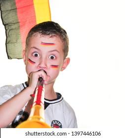 a boy plays vuvuzela in Germany jersey