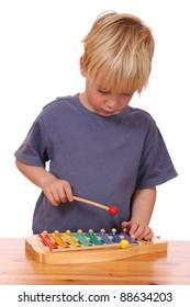 Boy plays xylophone