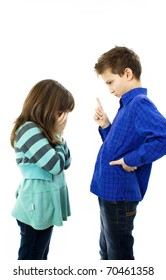 A boy pointing fingers on girl. Girl is crying. studio shoot