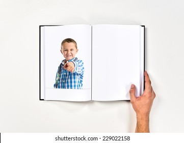 Boy pointing to the front printed on book