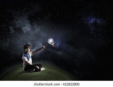 Boy pointing light bulb
