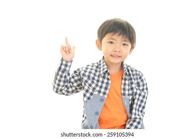 boy pointing overhead