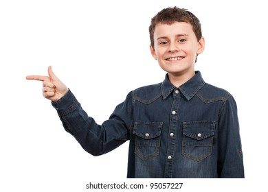 Boy pointing to the side of the image, isolated on white background