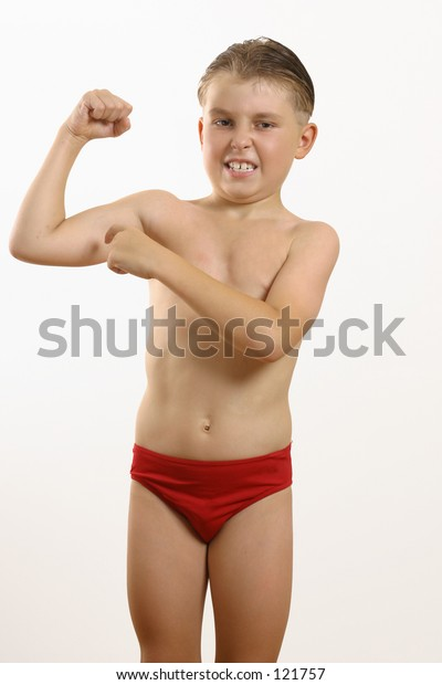 Boy points to muscle