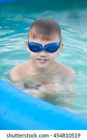 Boy in the pool having fun portrait
