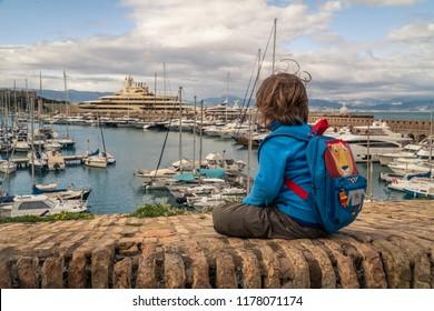 Boy in Port Vauban, Antibes, France. 10-04-2018