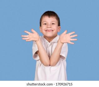 boy portrait in white shirt on blue