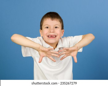 boy portrait in white shirt on blue background