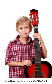 boy posing with guitar