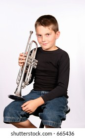 Boy posing with his trumpet