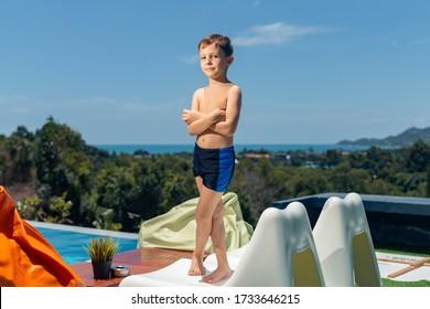boy posing on a background of sea landscape