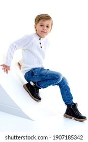 Boy posing in studio against white background.