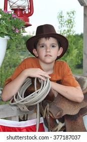 Boy posing in western scene