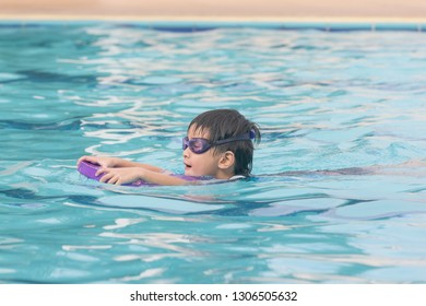 Boy Practice Swimming in pool.