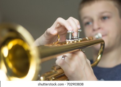 Boy Practicing on His Trumpet