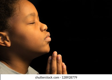 A boy prays to God.