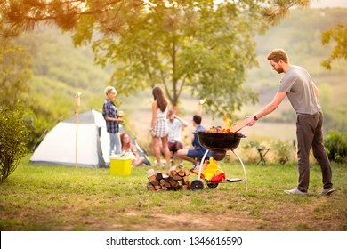 Boy prepare fire for grilling in nature