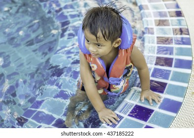 A boy preparing to swim  boy in water pool Children's zone for swimming