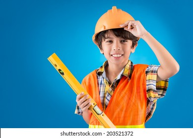 Boy pretending to be a construction worker