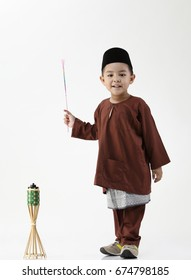 boy pretending playing firework and oil lamp