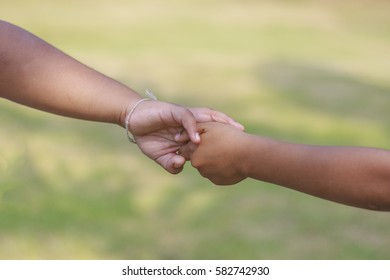 The boy pulling his brother's hand.( selection focus)