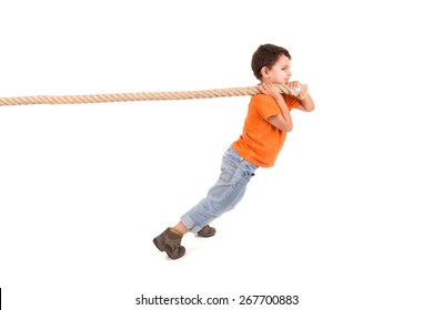 Boy pulling a rope isolated in white