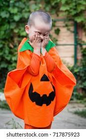 A boy in a pumpkin costume. Children celebrate Halloween