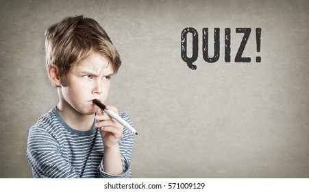Boy with Quiz text on grunge background, writing and thinking, copy space