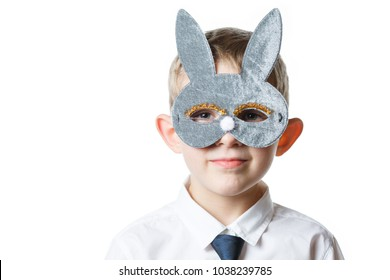 boy in a rabbit mask on a white isolated background, schoolboy in school uniform, happy child in a bunny mask