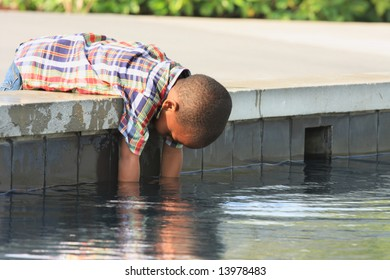 Boy Reaching into the Water