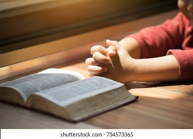 a boy reading bible.