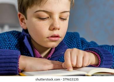 boy reading a book close up portrait