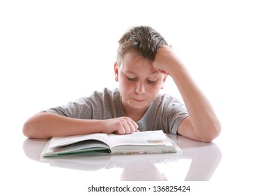 boy reading a book on a white background