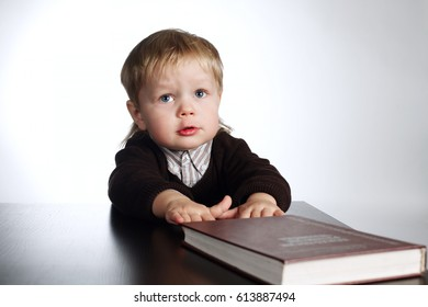boy reading book on white background