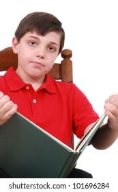Boy reading a boring book