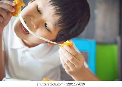 Boy ready to eat sticky stretch fried cheese ball - people and delicious cheese food concept